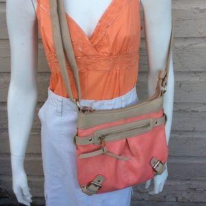 Charming Charlie cross-body bag in peachy pink/tan